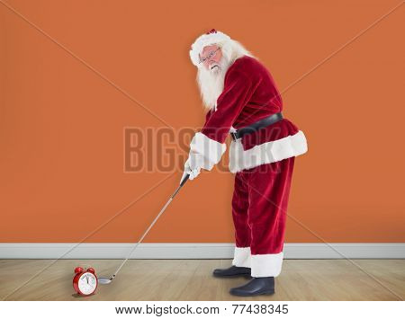 Santa Claus is playing golf against room with wooden floor