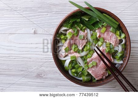 Vietnamese Pho Bo Soup With Beef Close Up. Top View