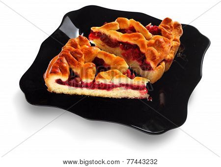 Homemade Pie with plums and raspberries decorated lattice on white background