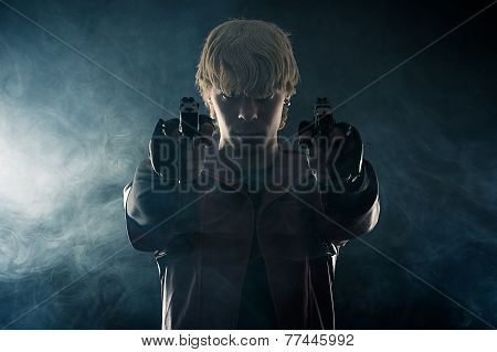 hero with pistols in hands aiming