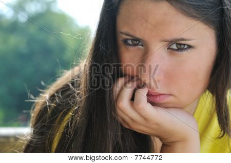 Young Woman In Depression Outdoors
