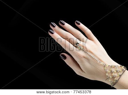 Manicured Nail With Black Matte Nail Polish.