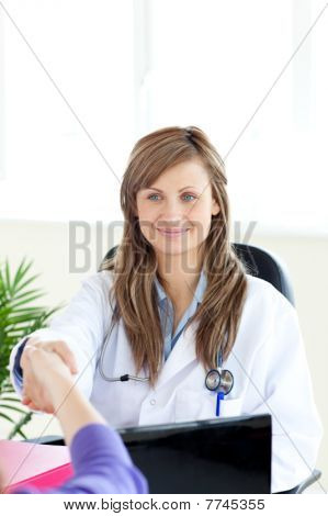 Attractive Female Doctor Shaking A Hand