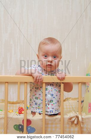 beautiful baby in a cot
