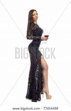 Alluring Sexy Woman In Evening Dress Posing With Glass Wine Isolated On White