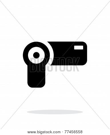 Hand-held camera simple icon on white background.