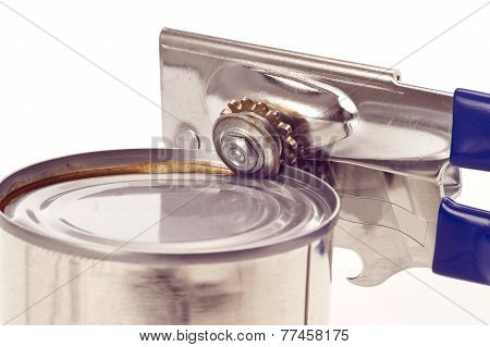 Manual Can Opener Attached To Can