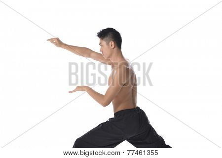 portrait of young smiling man athlete doing warming exercises isolated on white background. Concept of sport, health, keeping fit