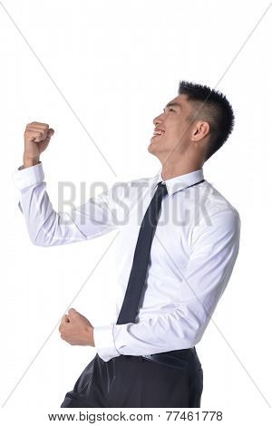 portrait of a excited young executive posing with arms up