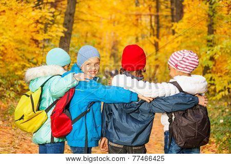 Back view of schoolchildren row standing close