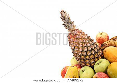 Group of tropical fruits on white background from corner