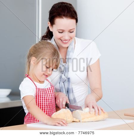 Portrait Of A Smiling Mother And His Daughter Preparing A Meal