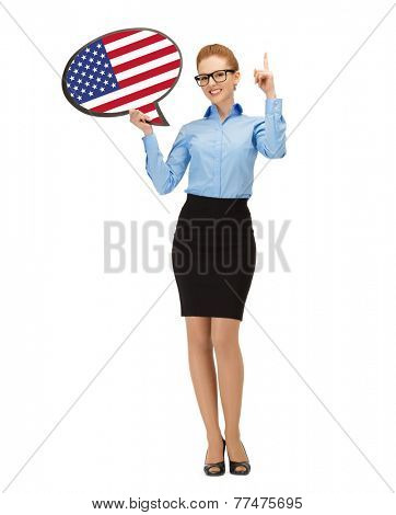 education, foreign language, english, people and communication concept - smiling woman holding text bubble of american flag and pointing finger up