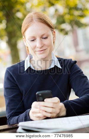 Businesswoman Texting During Lunch Break