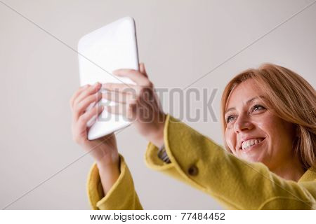 Pretty Blonde Woman Using A Tablet