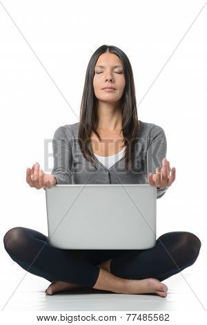 Pretty Woman Meditating With Laptop