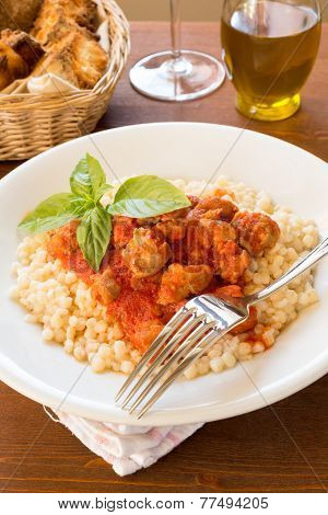 Fregola with sausage and tomato
