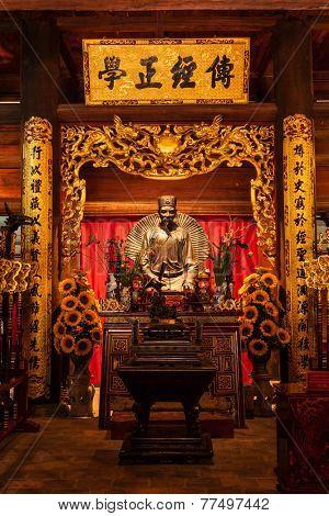 HANOI, VIETNAM - JUNE 11, 2011: Confucius statue at the Temple of Literature. This temple is dedicated to Confucius, sages and scholars
