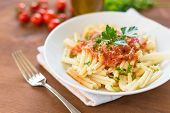 foto of italian parsley  - dish of italian pasta topped with tomato sauce and parsley  - JPG