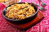 image of stew  - Cabbage stewed with meat in portions pan black - JPG