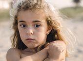 foto of shy girl  - Portrait of a shy girl on the beach  - JPG
