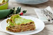 stock photo of lasagna  - Spinach sheets lasagna filled with meat sauce - JPG