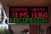 stock photo of pesos  - Mexican peso to US dollar exchange rate posted on sign in front of money exchange window in Tijuana Mexico on November 13 2014 - JPG