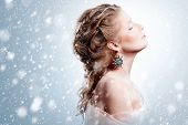 stock photo of snow queen  - Winter beauty woman portrait with snowfall - JPG