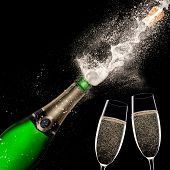 foto of explosion  - Champagne explosion on black background - JPG