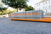 picture of movable  - movable fences stand on a platform of a truck in the middle of a square - JPG