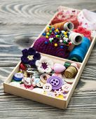 foto of handicrafts  - thread and material for handicrafts in box on a wooden background - JPG
