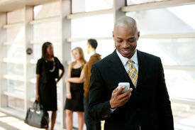 picture of mobile-phone  - A business man with a smart phone and co - JPG