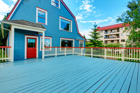 stock photo of red siding  - Blue house with large walkout deck - JPG