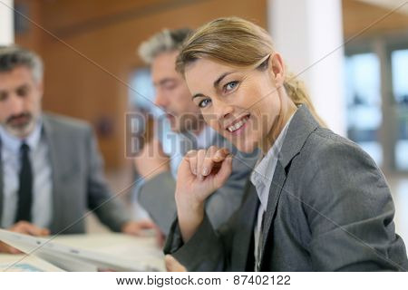 Portrait of executive woman in business meeting