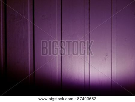 Violet Wooden Background With Light Beam