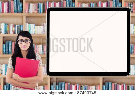 College Student With Billboard In Library