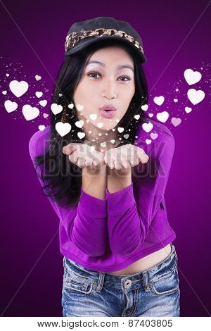 Attractive Teenage Girl Blowing Kiss