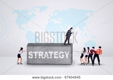 Male Leader And His Team With Strategy