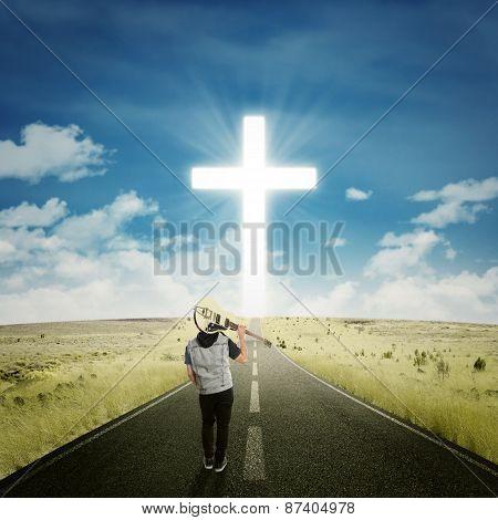 Male Musician Walking To The Cross