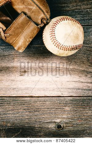Old Baseball And Worn Mitt On Old Wood With Vintage Style