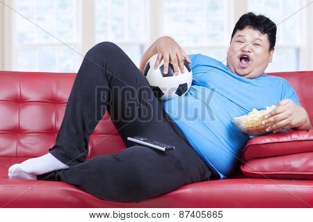 Overweight Man Watching Football Match