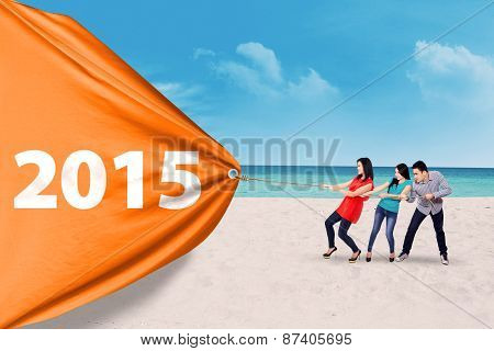 People Drag A Big Banner With Number 2015