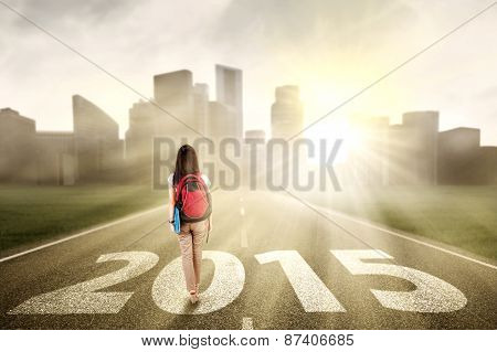 Student Walking Towards A City