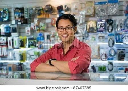 Chinese Man Working As Clerk Sale Assistant In Computer Shop