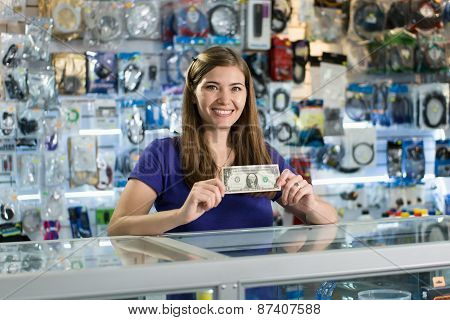 Happy Female Computer Shop Owner Showing First Dollar Earn