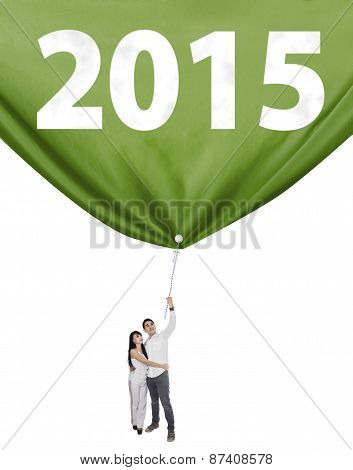 Two People Pulling A Flag New Year