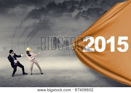 Two People Pulling Number 2015