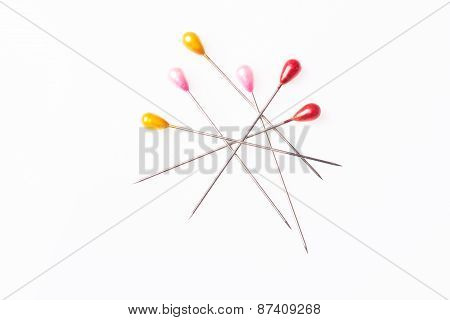 Many sewing push pins isolated on white background