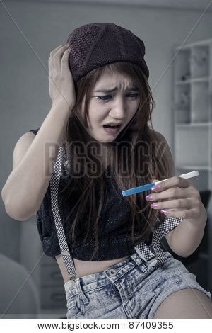 Worried Girl Holding Pregnancy Test