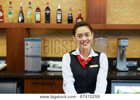 DUBAI, UAE - APRIL 07, 2013: Emirates business lounge staff. Emirates is one of two flag carriers of the United Arab Emirates along with Etihad Airways and is based in Dubai.